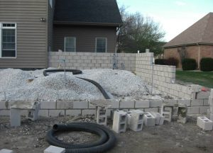 Construction on a large stone outdoor living space