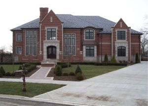 decorative cement driveway, brick walkway and steps
