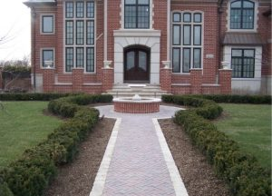 decorative brick walkway and water feature