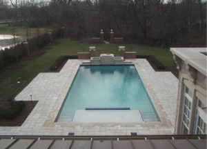 large stone walkways around a swimming pool