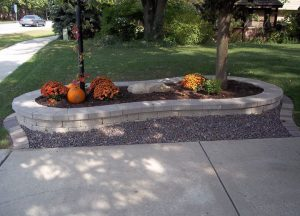 stone flower bed with orange flowers