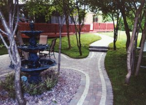 decorative brick walking paths and water feature