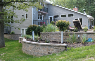 large home and yard with 2 retaining walls