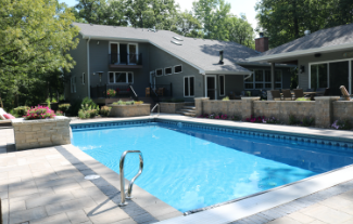 Pool area with paver patio, retaining walls, and flower boxes